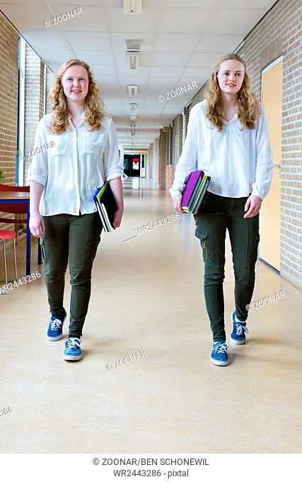 Two dutch teenage girls walking in long school cor
