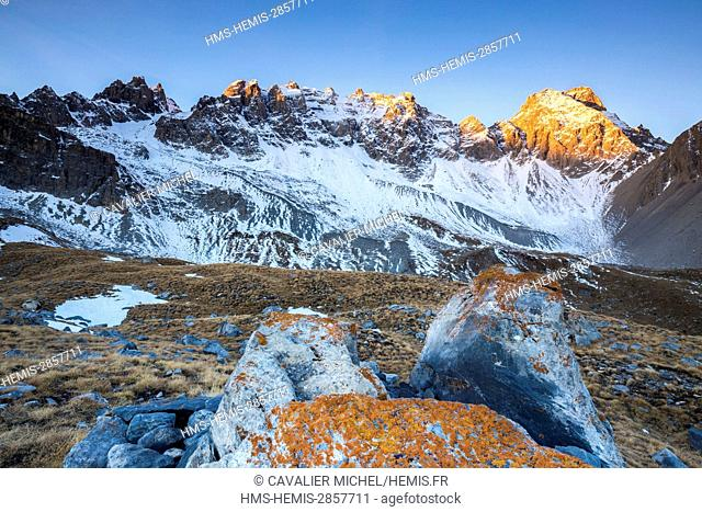 France, Hautes Alpes, regional natural reserve of Queyras, Ceillac, the Peaks of Font Sancte (3385m) illuminated by the sunrise of the sun seen since the GR 5...