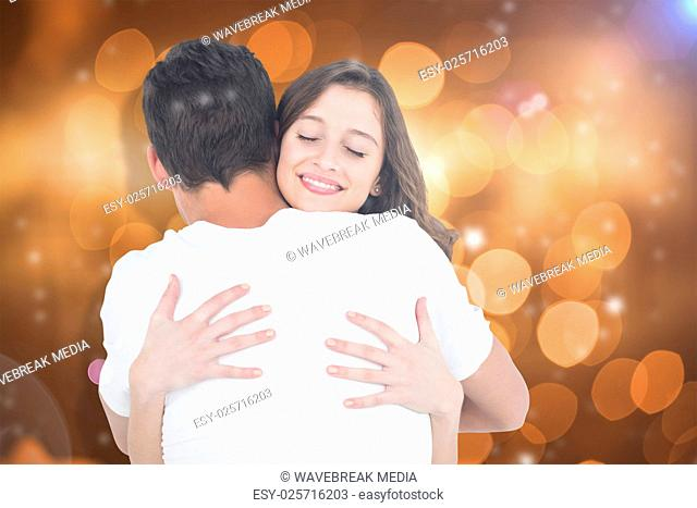 Composite image of close up of couple hugging
