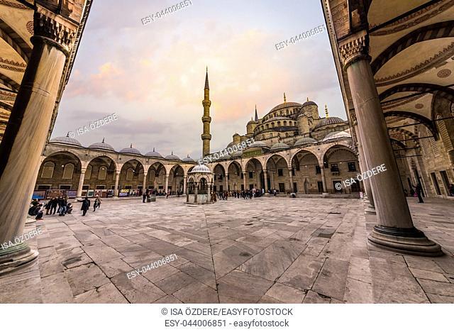 Unidentified people walk at Sultanahmet courtyard,popular destination in ISTANBUL, TURKEY- MARCH 11,2017