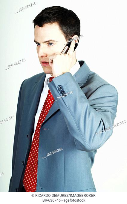 Young businessman making a call with his mobile phone