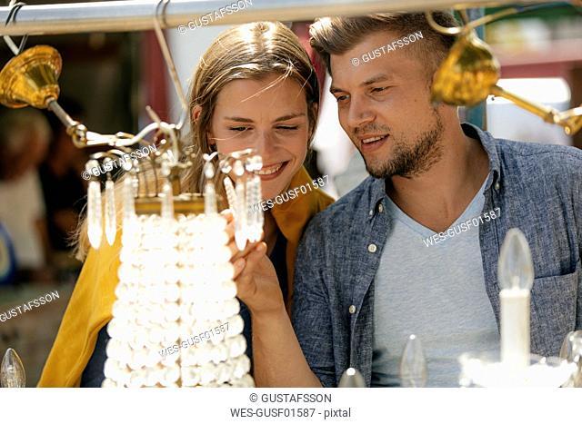 Belgium, Tongeren, happy young couple on an antique flea market
