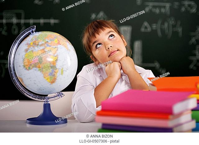 Little schoolgirl dreaming in classroom, Debica, Poland