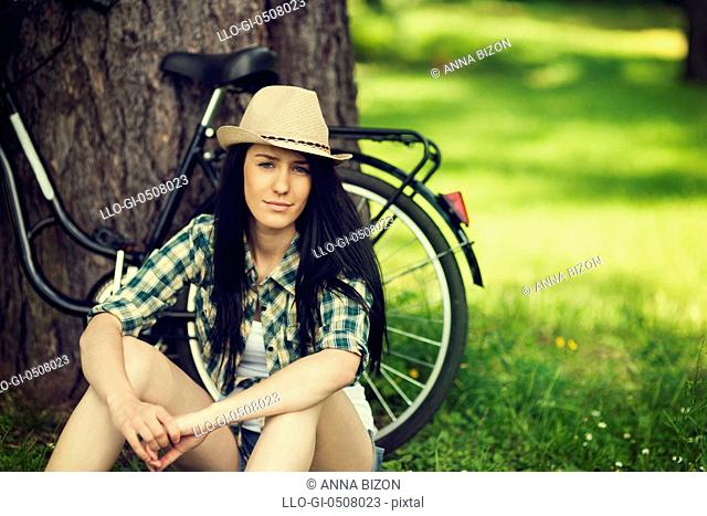 Beautiful young woman resting in park, Debica, Poland