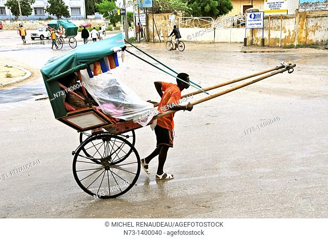 Africa, Madagascar, Toliara Tulear, the famous Rickshaw, legacy migration flows from Asia colorful rickshaws carrying people or goods