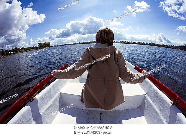 Caucasian woman rowing boat