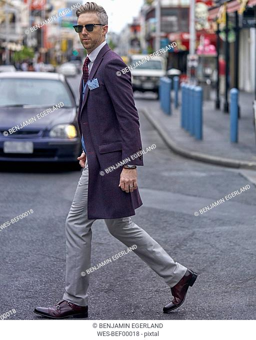 Portrait of fashion blogger Steve Tilbrook walking in the city