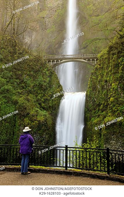 Multnomah Falls- Tourist taking pictures from the bridge Columbia Gorge National scenic area Oregon