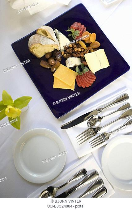 Fruit and cheese platter on table