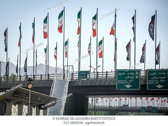 Iranian flags on a road above higway in Tehran city, capital of Iran and Tehran Province