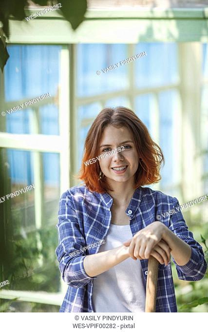 Smiling female gardener in garden