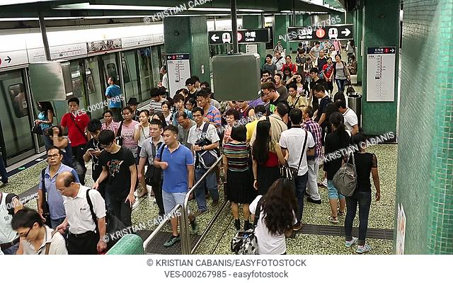 People getting of a MTR station with train, Hong Kong, China, Asia