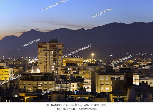 Cityscape of the city of Elche at night. Horizontal Shot