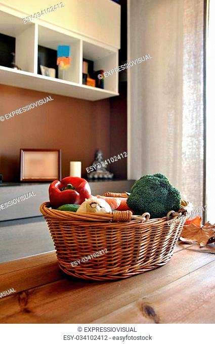 wicker basket with a variety of vegetables in a home