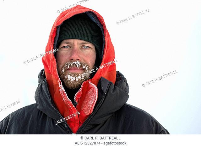 Portrait Of Man With A Frozen Beard On Kahiltna Glacier At -40 F, Denali National Park, Interior Alaska, USA
