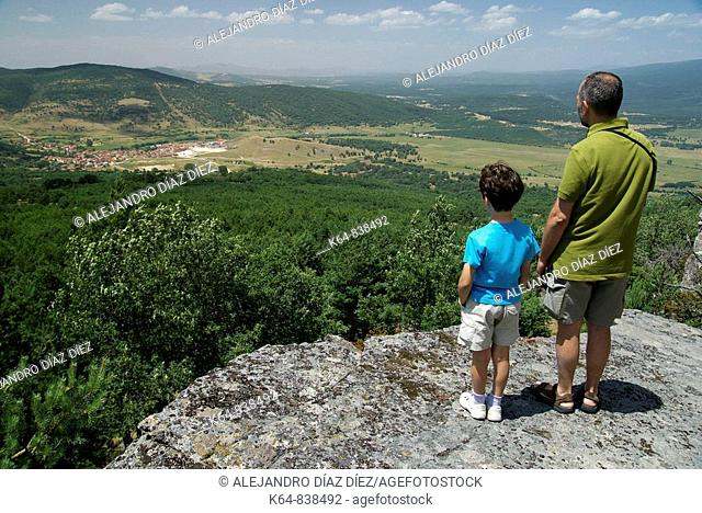 Father and daughter looking at Canicosa de la Sierra, Burgos