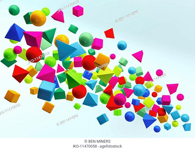 Abstract floating cluster of multicolored geometric shapes on blue background