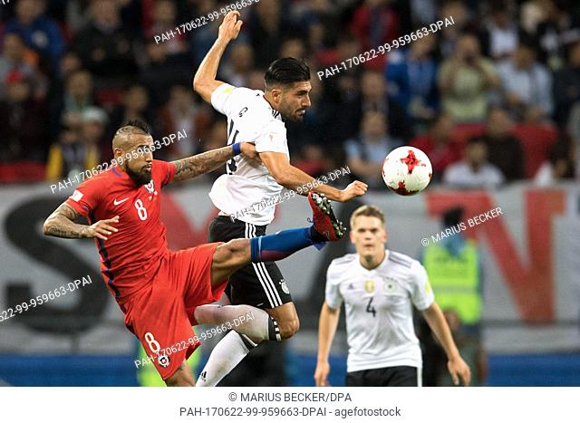 Germany's Emre Can (C) and Chile's Arturo Vidal vie for the ball during the Confederations Cup group stages Group B soccer match between Germany and Chile in...