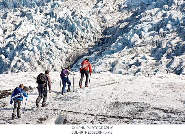 Family walking on glacier