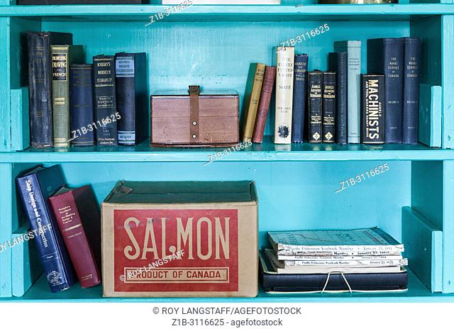 Selection of older technical books on a shelf at the heritage Britannia Boat Yard in Steveston, British Columbia