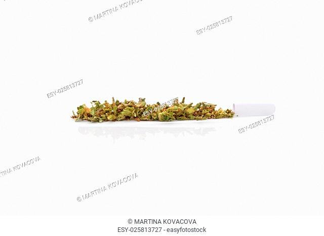 Marijuana bud and cigarette rolling paper isolated on white background. Smoking cannabis, addiction or medical use
