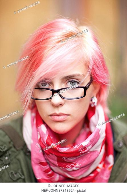 Portrait of a young woman with pink hair and scarf, Sweden
