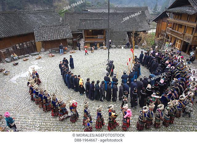 China , Guizhou province , Langde village , Long Skirt Miao people in traditional dress , mens are playing lusheng ,