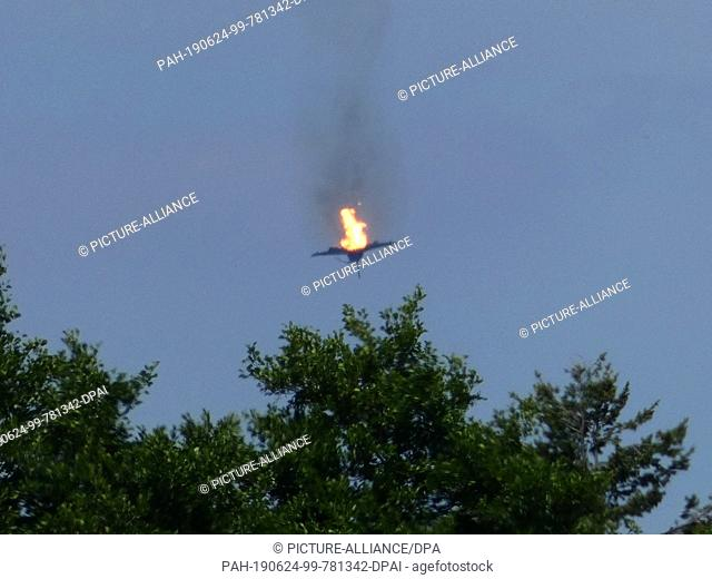"24 June 2019, Germany (German), Malchow: A burning airplane of the type """"Eurofighter is to be seen in the sky over Malchow"