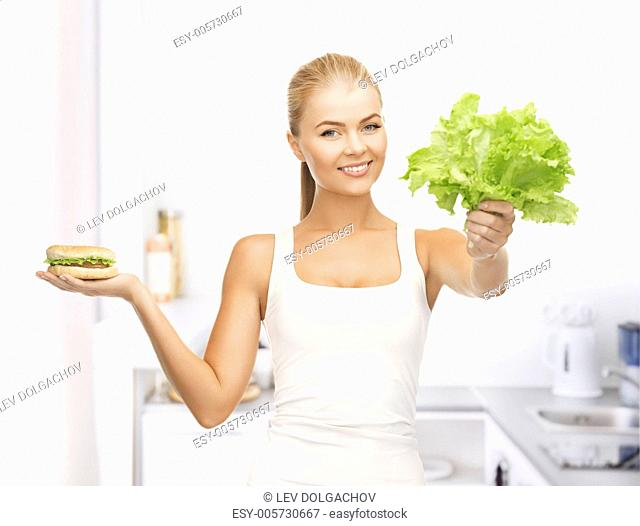 picture of sporty woman with green leaves and hamburger