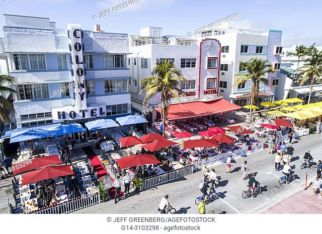 Florida, Miami Beach, Ocean Drive, Art Deco District, Colony Boulevard Starlite, hotel hotels, retaurant, alfresco, umbrellas, bicycle riders
