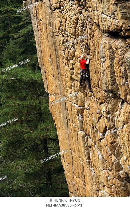 A rock climber in action