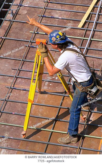 Worker at surveyor transit