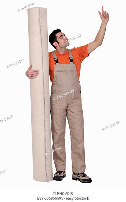 Handyman holding carpet isolated on white background