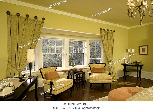 BEDROOM: citron color, tangerine and coral accents, sitting area, two arm chairs, window seat in alcove over radiatior, curtains tacked in place
