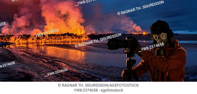 Photographer wearing a gas mask in front of glowing lava