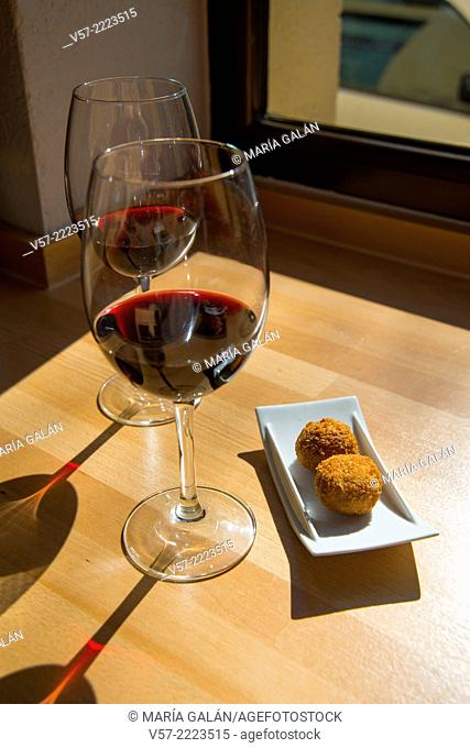 Spanish aperitif: two glasses of red wine and croquettes. Spain