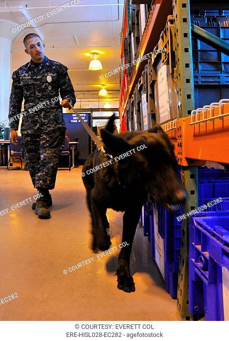 US Navy working dog Jake is put through detection training in a warehouse at Naval Base San Diego California. Jan. 26 2011