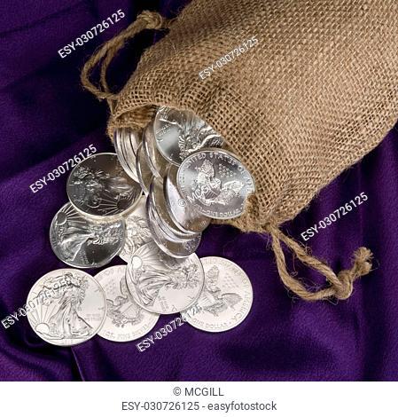 Burlap sack of silver eagle dollars