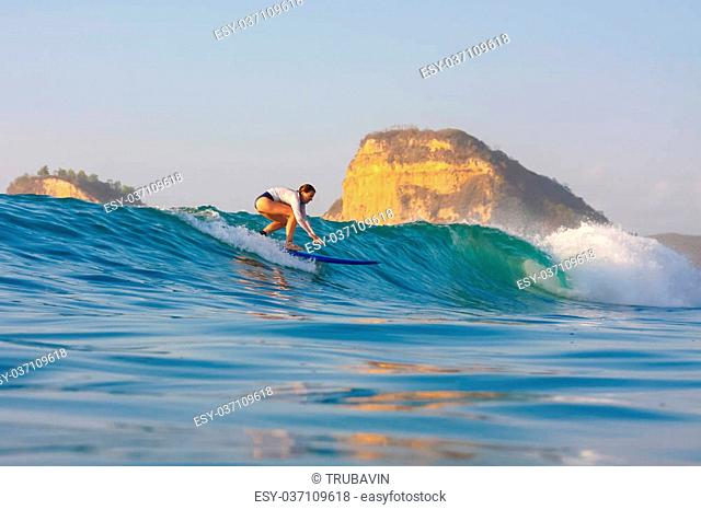 Picture of the Surfer in the Ocean.Lombok Island.Indonesia