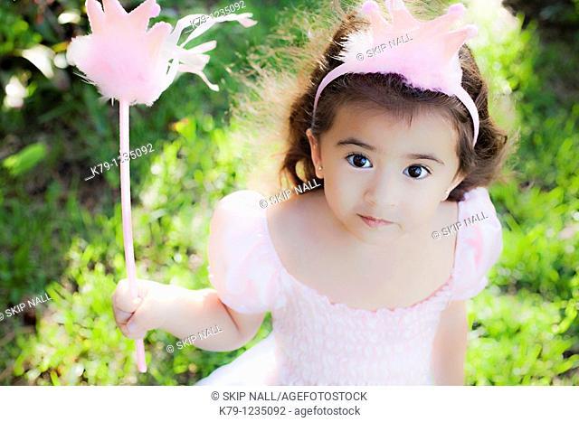 Little girl playing dress up as a princess