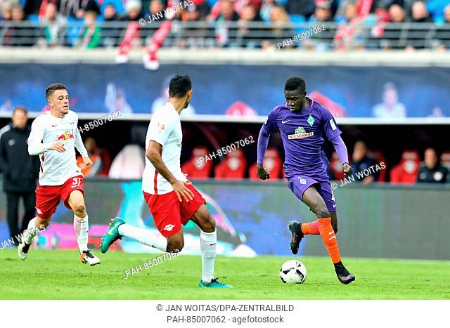 Bremen's Ousman Manneh (R) and Leipzig's Marvin Compper (M) and Diego Demme play against each other during the German Bundesliga soccer match between RB Leipzig...