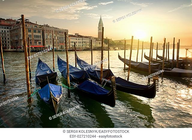 Gondolas and architecture in Venice at sunset, Italy
