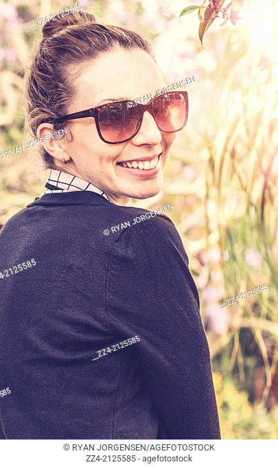 Smiling happy woman in sunshades looking when enjoying the retro sun in outback Australia. Australian tourist