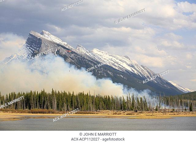 Helicopter fighting a forest fire in Banff National Park, Alberta, Canada