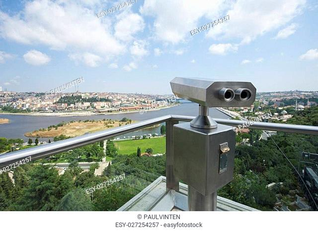 Pair of binoculars on an aerial viewing platform overlooking istanbul from famous Pierre Loti Cafe