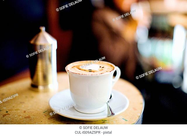 Cappuccino with heart shaped foam on coffee bar table, Florence, Italy