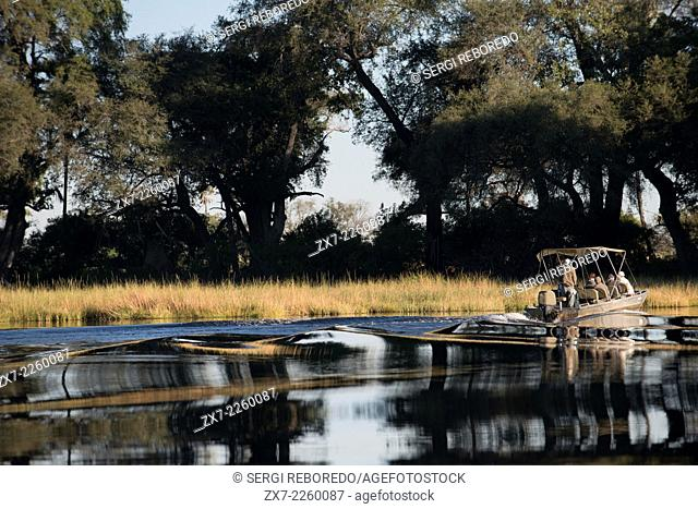 A speedboat sails the Okavango Delta on an organized camp from Eagle Island Camp by Orient Express , outside the Moremi Game Reserve in Botswana safari water
