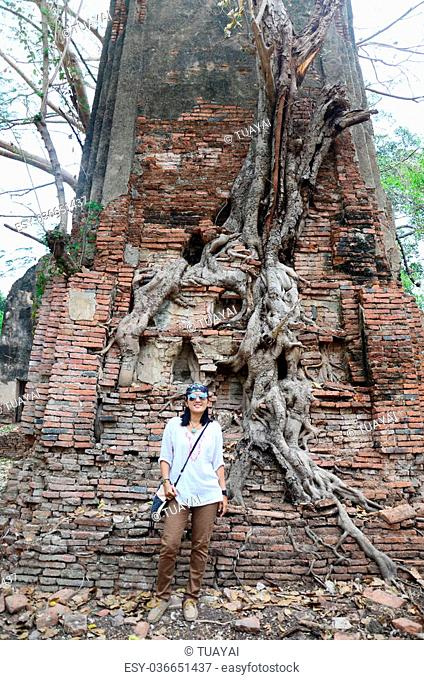 Thai woman portriat with Ruins of ancient building at Ayutthaya historical park in Ayutthaya, Thailand