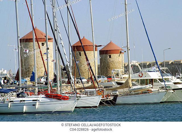 Mandraki harbour, old city. Rhodes. Dodecanese, Greece