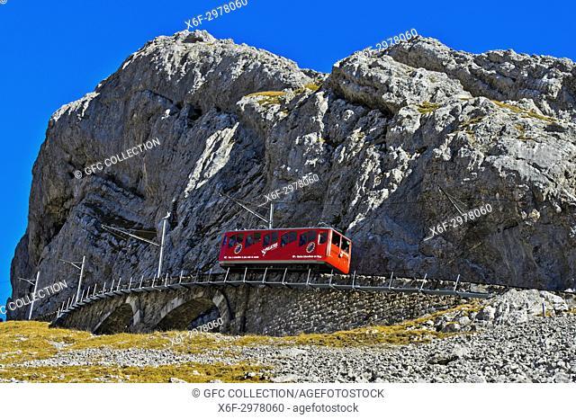 Red railcar of the Pilatus Railway on the way to the top, Pilatus massif, Alpnachstad, Switzerland